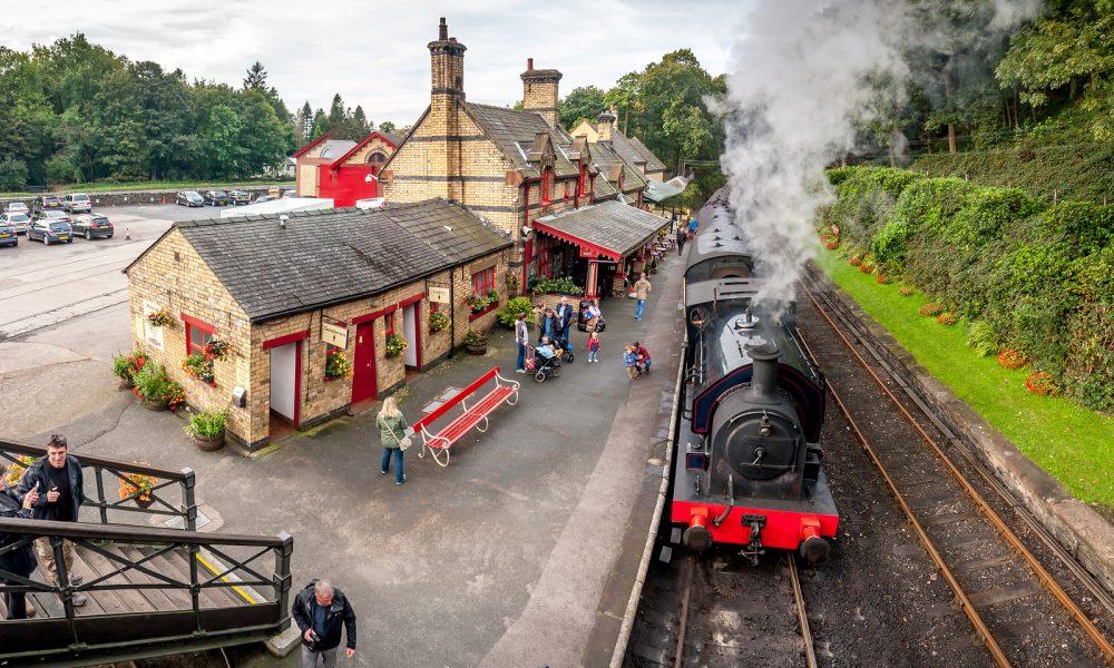 Tourists waiting at Haverthwaite Station part of Lakeside and Haverthwaite Railway. 4 image panorama: Haverthwaite, Cumbria, England, UK. October 4, 2016.